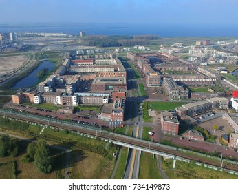 Aerial (drone) view of Europalaan in Europakwartier, Almere Poort, The Netherlands. The Europa kwartier is the middle of Almere Poort.