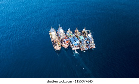 Aerial drone view of fishing trawlers in the ocean in asia