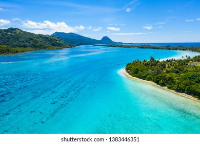 Aerial drone view of French Polynesia Tahiti island Huahine and Motu coral reef lagoon and Pacific Ocean. Tropical paradise.