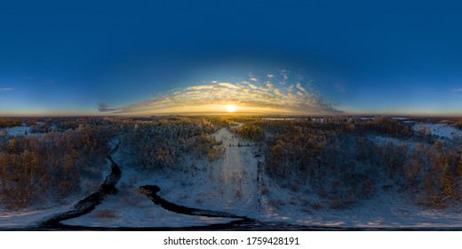 An aerial drone view of the frozen Jagala river, Estonia at sunset 360 degrees panorama. Winter landscape.
