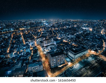 Aerial Drone View of Futuristic City Skyline with Starry Night Sky in Tokyo, Japan