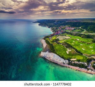 Aerial drone view of a golf course next to the cliffs and Black sea. Golfing fields landscape.