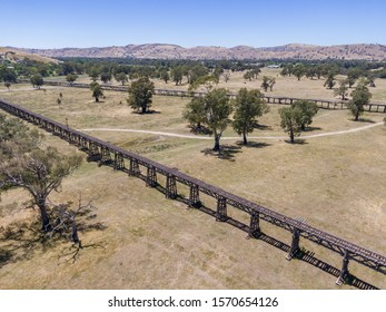 Aerial drone view of the historic Gundagai Railway Viaduct, part of the disused Tumut Railway line near Murrumbidgee River in Gundagai, New South Wales, Australia. The site is a popular for tourists.