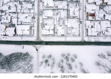 aerial drone view of houses and road. winter landscape