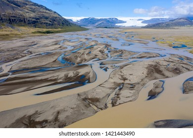 Aerial drone view of a huge riverbed and delta, glacial river system transporting deposits from the Vatnajokull glacier showing unique patterns, Southern Iceland