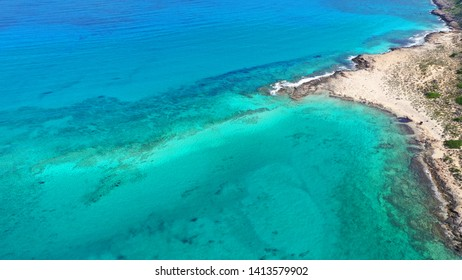 Aerial drone view of iconic Balos beach and lagoon near Gramvousa island with turquoise clear sea and pure white sand, Crete island, Greece