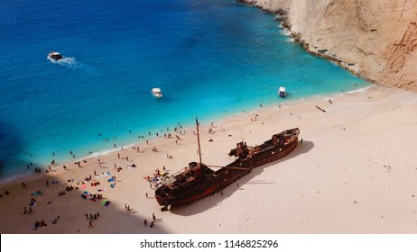 Aerial drone view of iconic beach of Navagio or Shipwreck voted one of the most beautiful beaches in the world with deep turquoise clear sea, Zakynthos island, Ionian, Greece