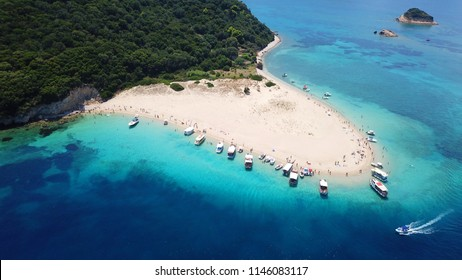 Aerial drone view of iconic small island of Marathonisi featuring clear turquoise water sandy shore and natural hatchery of Caretta-Caretta sea turtles, Zakynthos island, Ionian, Greece