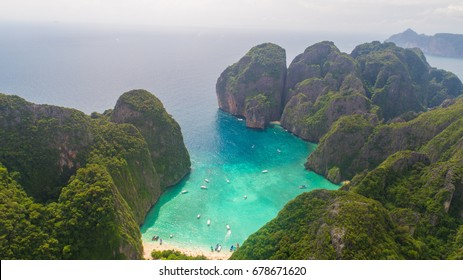 Aerial drone view of iconic tropical turquoise water Maya Bay surrounded by limestone cliffs, Phi Phi islands, Thailand