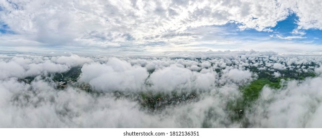 Aerial drone view of Lampang city Thailand, The mist of the rainy season in the morning, The form of banners for the concept.