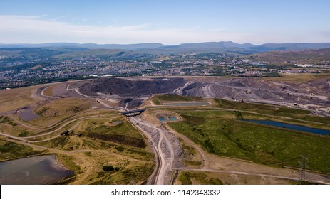 Aerial drone view of a large, buried landfill dump site in Wales