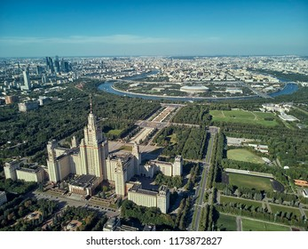 Aerial drone view of Lomonosov Moscow State University (MGU, MSU) on Sparrow Hills, Moscow, Russia. Panorama of Moscow with the Main building of MSU. Beautiful park area in Moscow from above.