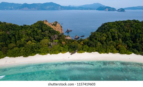 Aerial drone view of a long sandy beach on a beautiful tropical island in the Mergui Archipelago, Myanmar