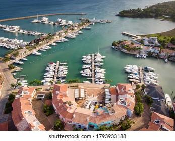 Aerial drone view of luxury yacht marina (port) with european style buildings in Casa de Campo, La Romana, Dominican Republic