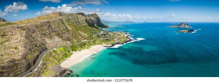 Aerial drone view of Makapuu beach landscape and blue seascape with State Seabird Sanctuary and Rabbit Island off Makapuu Point on Oahu, Hawaii, USA.