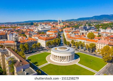 Aerial drone view of Mestrovic pavilion, monumental art gallery and cathedral in city centre on sunny summer day, Zagreb, Croatia