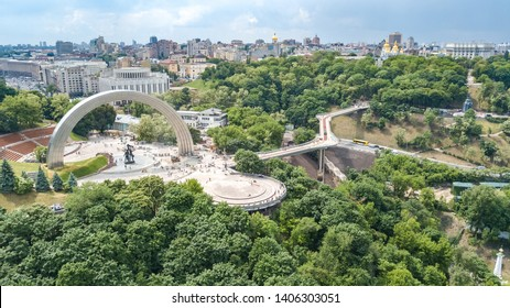 Aerial drone view of new pedestrian cycling park bridge construction, hills, parks and Kyiv cityscape from above, city of Kiev skyline, Ukraine