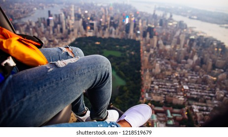 Aerial drone view  of new york city. Couple taking a tour on the helicopter