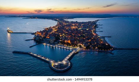 Aerial drone view at night to Pomorie city on the Bulgarian Black Sea coast