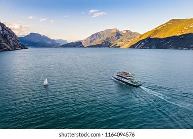 Aerial drone view on car ferry on Lake Garda in Italy, Limone sul Garda