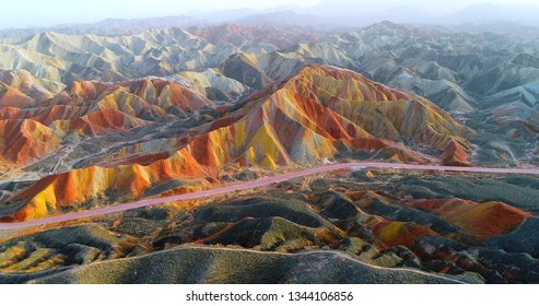 Aerial drone view on most colorful mountain on earth, and the most vivid one within the Zhangye Danxia National Geological Park. Multicolored slopes covered by striped pattern, a unique landscape.