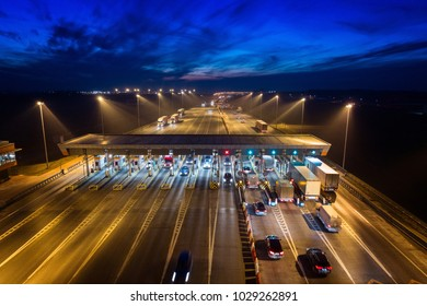 Aerial drone view on toll collection point on motorway at night. Pay road, Gliwice, Poland