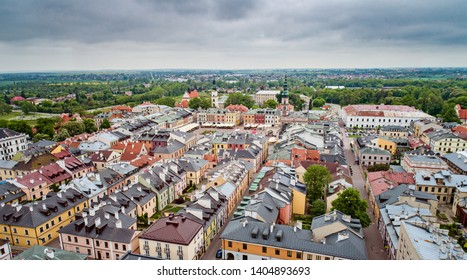 Aerial drone view on Zamosc old town and city main square with town hall. Zamosc is a city in southeastern Poland, situated in the southern part of Lublin Voivodeship. Zamosc, Poland, Europe