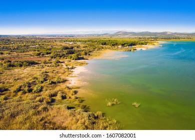 Aerial drone view of ornithological nature park, shore of Vrana lake (Vransko jezero) in Dalmatia, Croatia - Shutterstock ID 1607082001