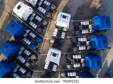 Aerial drone view of parked trucks. Road transport