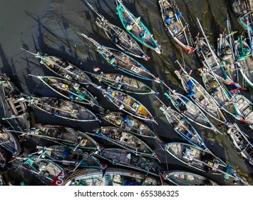 An aerial drone view of parking fishing boat in Muncar fishing harbor. Muncar is the one of the biggest fishing harbor in South East Asia and Indonesia.