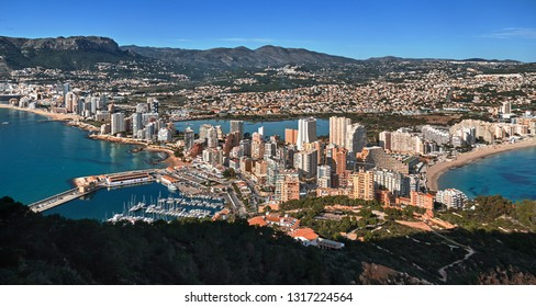 Aerial drone view picturesque photo from above Calpe cityscape salt lake, bay of Mediterranean Sea the both sides photo taken from Ifach rock. Province of Alicante, Costa Blanca, Spain