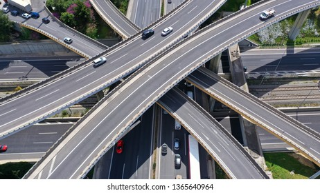 Aerial drone view of popular highway multilevel junction road, passing through National motorway in traffic jam
