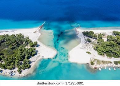 Aerial drone view of Port Glarokavos and lagoon beach in Chalkidiki Greece