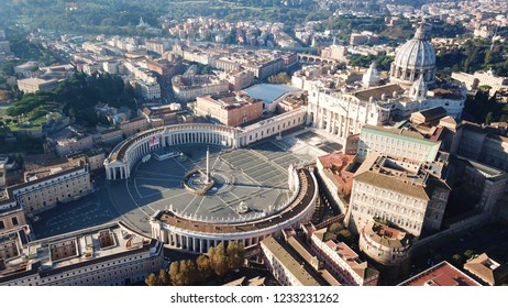 Aerial drone view of Saint Peter's square in front of world's largest church - Papal Basilica of St. Peter's, Vatican - an elliptical esplanade created in the mid seventeenth century, Rome, Italy