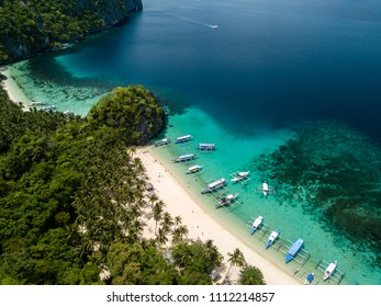 Aerial drone view of the scenic 7 Commando and Papaya beaches in El Nido, Palawan