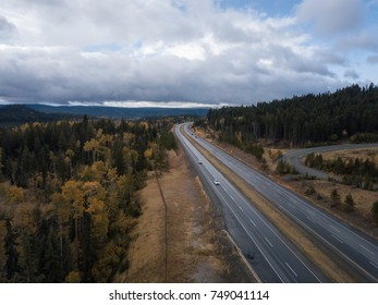 Aerial drone view of a scenic highway, Coquihalla Hwy, in the country side during an Autumn season. Taken near Kamloops, British Columbia, Canada.