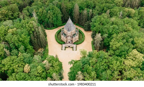 Aerial drone view of Schwarzenberg Tomb near Trebon, Czech Republic.Neo-gothic building with tower and majestic double staircase is surrounded by English park.Architectural tourist monument  - Shutterstock ID 1983400211