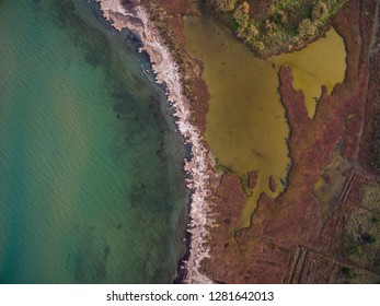 Aerial drone view of the sea and marsh land.