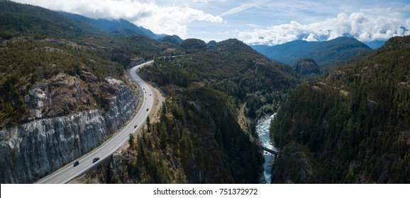 Aerial drone view of Sea to Sky Highway during a bright summer day. Taken between Squamish and Whistler, North of Vancouver, British Columbia, Canada.