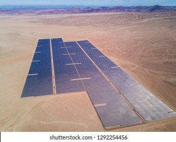An aerial drone view of a Solar Energy Photovoltaic PV Plant over the Atacama desert in Chile, trying to get the energy from the sun with Solar Energy in the driest desert in the world: Atacama