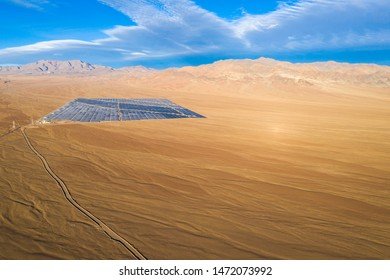 Aerial drone view of a Solar Energy Photovoltaic Power Plant over Atacama desert sands, Chile. Sustainability and green energy from the sun with Solar Energy in the driest desert in the world: Atacama