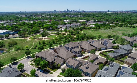 Aerial drone view with Solar panel rooftop one the leading renewable and sustainable energy Efficiency neighborhood in Austin, Texas the Mueller suburb is covered in rooftop solar energy high angle
