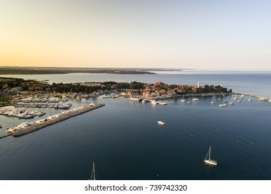 aerial drone view of sunrise over novigrad in summer