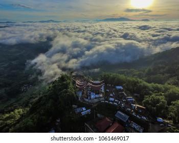 Aerial drone view of Toraja traditional house called Tongkonan during sunrise from Tongkonan Billa, Lolai, North Toraja, Indonesia.