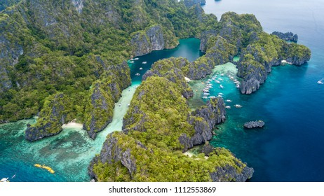 Aerial drone view of tourist boats around the beautiful big and small lagoons in El Nido, Palawan