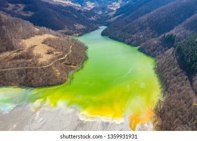 Aerial drone view of toxic chemical residuals flooding a lake from a copper and gold mine exploitation. Environmental damage, ecological bomb in Geamana, Rosia Montana, Romania