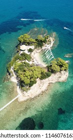 Aerial drone view of tropical caribbean vegitated islet with small beach with turquoise clear waters