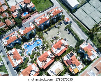 Aerial drone view of tropical residence  (residential complex) with a few blocks and the pool in Bavaro, Punta Cana, Dominican Republic