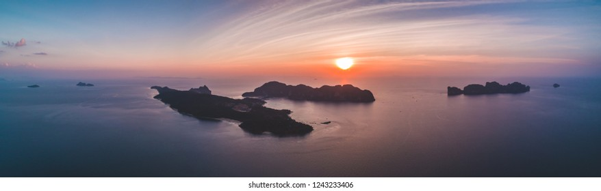 Aerial drone view of tropical silhouette islands in sunset time. Indian ocean. Travelling and holiday concept. Top view panorama. Travel Background. Nature landscape.