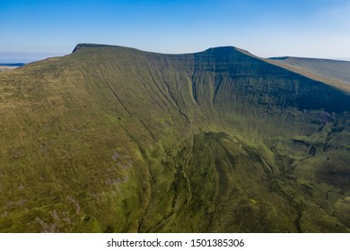 Aerial drone view of the twin peaks of mountains Corn Du and Pen-y-Fan in the Brecon Beacons of Wales, UK